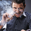 Portrait of a man smoking cigar — Stock Photo #5311198