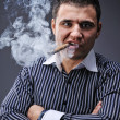Portrait of a man smoking cigar — Stock Photo #5311200