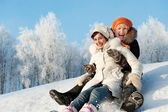 Mother and daughter sliding in the snow — Fotografia Stock