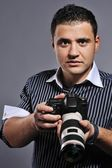 Handsome man with a photocamera — Stock Photo