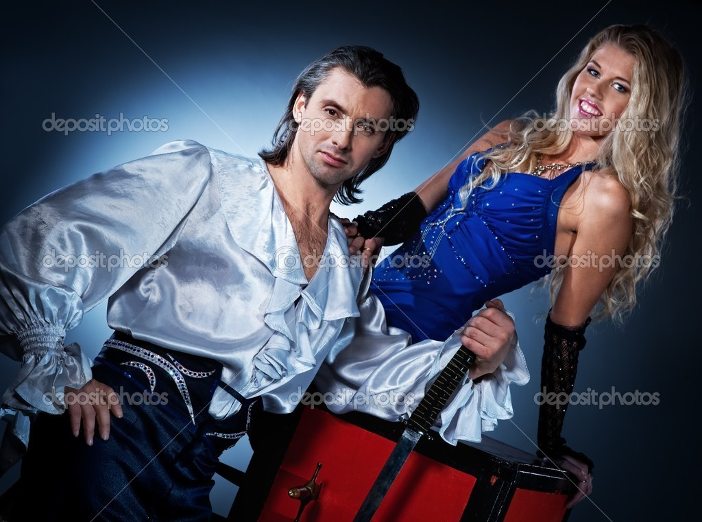 Attractive couple performing sword box illusion — Stock Photo #5310600