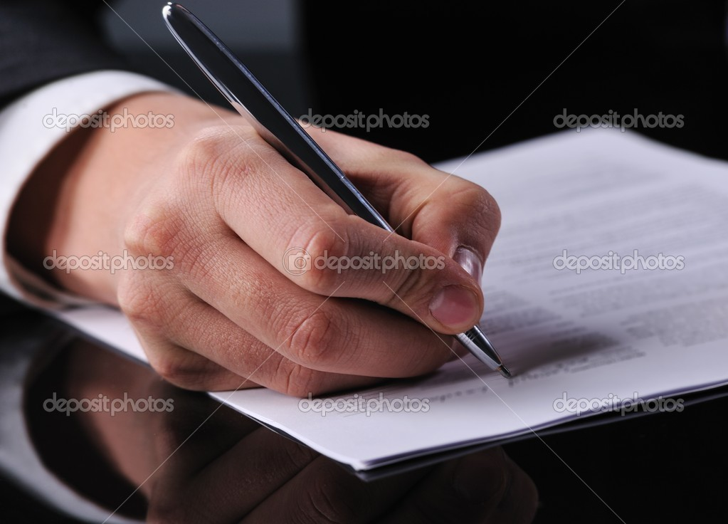 Businessman writing on a form  — Stock Photo #5310956