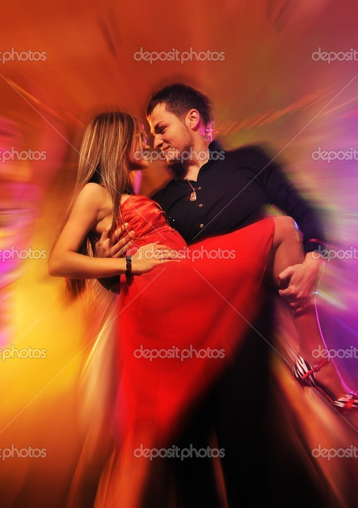 Young couple dancing in the night club  — Stock Photo #5310990
