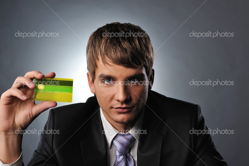 Handsome man holding credit card — Stock Photo #5311044