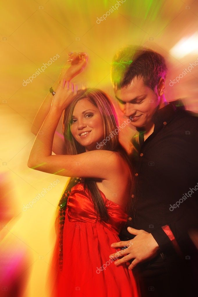 Young couple dancing in the night club  — Stock Photo #5311194
