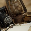 Retro camera, kerosene lamp and old photos — Stock Photo