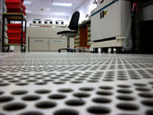 Ventilated floor with apertures in a clean room — Stock Photo
