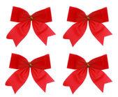 Four xmas red bow on white background — Stock Photo