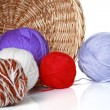 Multi-colored balls of yarn in wicker basket — Stock Photo