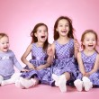 Four Happy young girl in violet dress laugh — Stock Photo