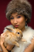 Beautiful woman with rabbit — Stock Photo