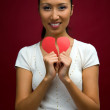 Woman with heart in her hands — Stock Photo #4757072