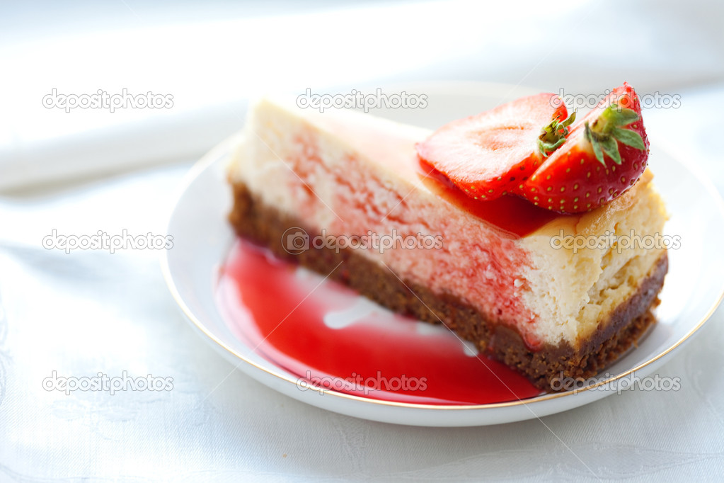 Cheesecake with a strawberry, a close up.  Photo #4141243