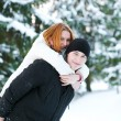 Guy and the girl enjoy winter walk - Stock Photo
