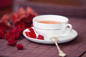 Black tea in a white cup — Stock Photo