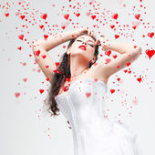 Beautiful brunette and hearts — Stock Photo