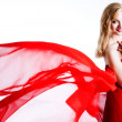 Red, beautiful blonde in a red dress - Stock Photo
