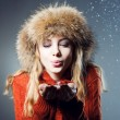 Stock Photo: Young beautiful girl rejoices to snow