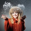 Young beautiful girl rejoices to snow — Stock Photo