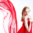 Stock Photo: Red, beautiful blonde in a red dress