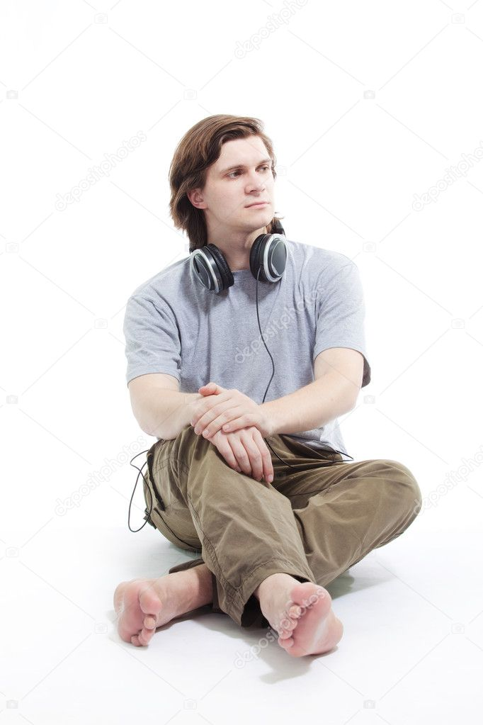 Young man listening music isolated on white   Stock Photo #5115868