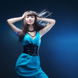 Beautiful girl in a blue dress — Stock Photo #5365334