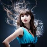 Beautiful girl in a blue dress — Stock Photo