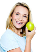 Young happy woman with green apple — Stock Photo