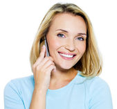 Happy woman speaks on the phone — Stock Photo