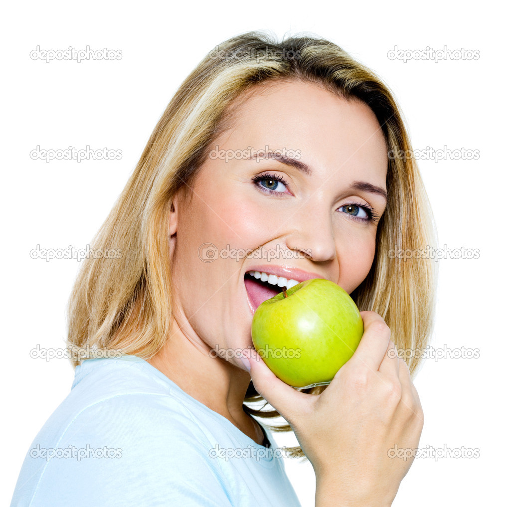 Young happy woman eats green apple - on white background  — Stock Photo #4010798