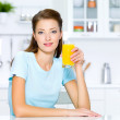 Girl hold a glass of fresh orange juice — Stock Photo #4036735
