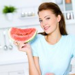 Young woman hold a red water-melon — Stock Photo #4036846