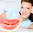 Woman near to a red water-melon — Stock Photo