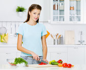 Woman cooking healthy food — Stock Photo