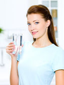 Woman holds a glass with water — Stock Photo