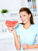 Young woman hold a red water-melon — Stock Photo