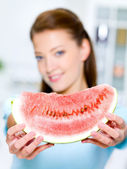 Woman shows a red water-melon — Stock Photo