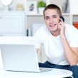 Man speaks on the phone and works on the laptop — Stock Photo #4083283