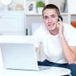 Man speaks on the phone and works on the laptop — Stock Photo