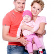 Foto Stock: Happy young famile with beautiful baby