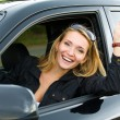 Woman in the new car with keys — Stock Photo #4089890