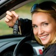 Woman shows keys from the car — Stock Photo #4089934