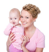 Beautiful mother with attractive smile baby — Stock Photo