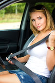 Woman fastens a seat belt in car — Stock Photo