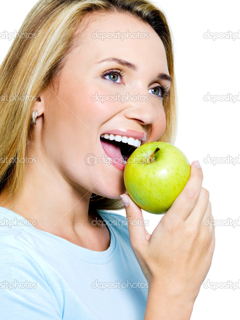 Smiling woman with green apple - isolated on white — Stock Photo #4089505