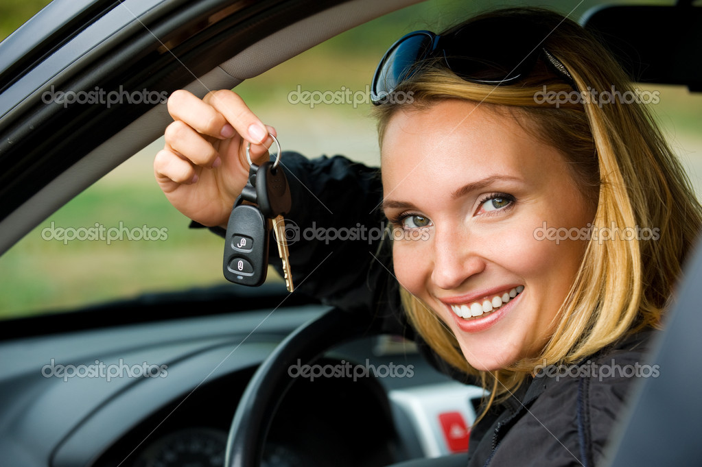 Attractive young happy woman shows keys from the new car - outdoors  Stock Photo #4089934