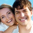 Beautiful couple on blue skiy — Stock Photo #4090090
