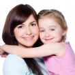 Girl embracing her mother — Stock Photo