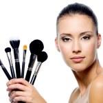Beautiful woman with makeup brushes — Stock Photo