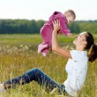 Happy young mather play with smiling baby — Stockfoto